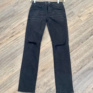Faded dark denim jeans with ripped knee cuts